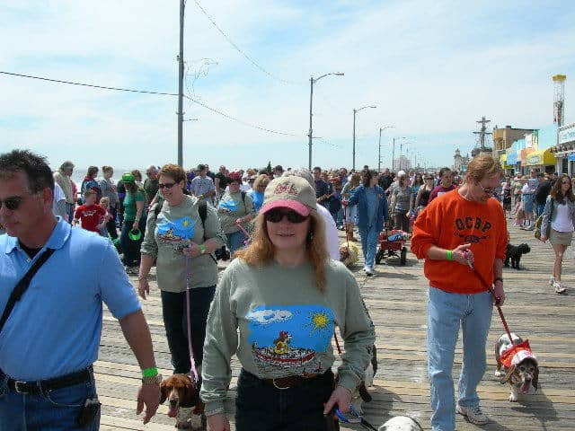 Debbie and Uncle Kevin with Precious waddle on the boardwalk