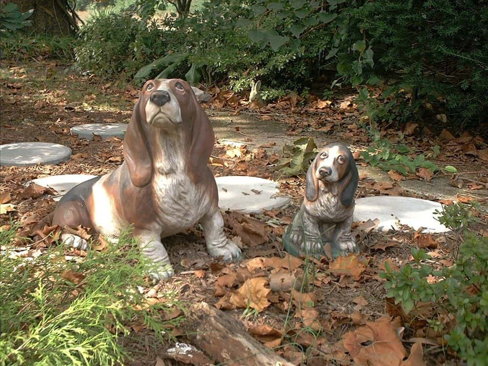 Basset and Puppy.  Debbie used her first Basset, Suzie, as model for both statues.